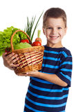 Smiling boy with basket of vegetables Royalty Free Stock Photos
