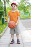 Smiling boy with basketball Royalty Free Stock Image