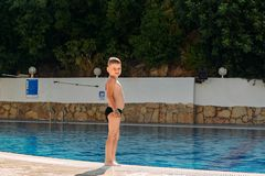The smiling boy in bathing trunks on vacation royalty free stock photography