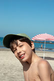 Smiling boy on the beach Royalty Free Stock Images