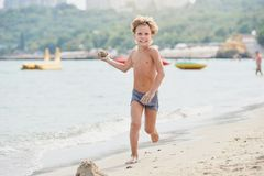Smiling boy on the beach royalty free stock photography