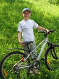 Smiling boy on bicycle Royalty Free Stock Photography