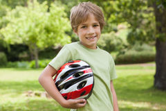 Smiling boy with bicycle helmet at park Royalty Free Stock Photos