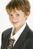 Smiling Boy in Big Suit Royalty Free Stock Photo
