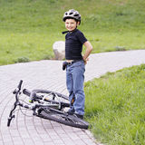Smiling boy and bike Stock Photos