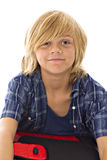 Smiling boy with binder. Young blond smiling boy isolated on white with red and black binder Royalty Free Stock Image