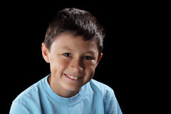 Smiling boy on black background Stock Photos