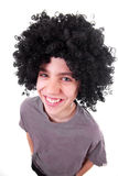 Smiling boy with black wig. Happy and smiling boy with black wig isolated on white background royalty free stock image