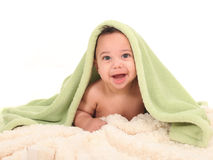 Smiling Boy With a Blanket on His Head Royalty Free Stock Image