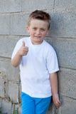 Smiling boy with blue eyes saying Ok Stock Photos