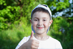 Smiling boy in blue hat Stock Images