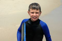 Smiling boy with bodyboard Stock Photography