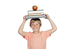 Smiling boy with books and a apple oh his head. Isolated on white background Stock Image