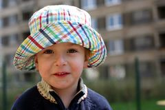 Smiling boy in a boonie hat royalty free stock image