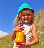 Smiling boy with a bottle of juice Stock Photography