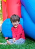 Smiling boy with bouncy castle Stock Photos