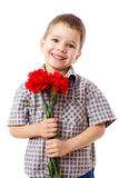 Smiling boy with bouquet of carnations Stock Photography