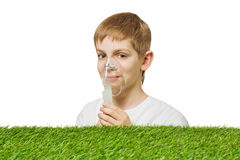Smiling boy breathing through inhalator mask Royalty Free Stock Images