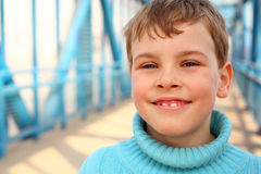 Smiling boy on bridge Royalty Free Stock Image
