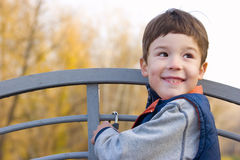 Smiling boy on the bridge portrait Stock Photography
