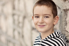 Smiling boy with brown eyes Stock Images