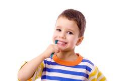 Smiling boy brushing teeth Royalty Free Stock Photo