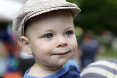 Smiling boy in cap Stock Images
