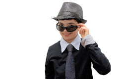 Smiling Boy with carnival costume. Man in black. Teenager in a carnival costume, wearing hat and sunglasses as a detective. Image isolated on white Stock Photo