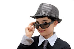 Smiling Boy with carnival costume. Teenager in a black carnival costume, wearing hat and sunglasses as a detective. Image isolated on white Royalty Free Stock Photos