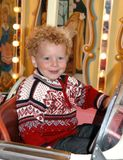 Smiling boy in carousel Royalty Free Stock Images