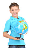 Smiling boy in casual  holding globe in hands Royalty Free Stock Images