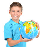 Smiling boy in casual  holding globe in hands Stock Images