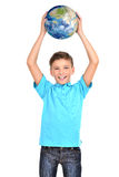 Smiling boy in casual  holding planet earth in hands above his h Stock Image