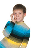 Smiling boy with a cell phone Stock Image