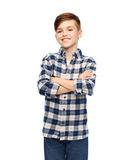 Smiling boy in checkered shirt and jeans Stock Photo