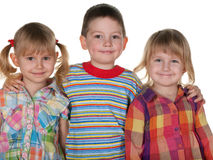 Smiling boy and cheerful girls Stock Image