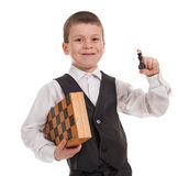 Smiling boy with chess Stock Photo
