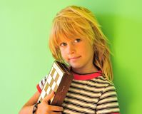 Smiling boy with chessboard. At green wall Royalty Free Stock Photography
