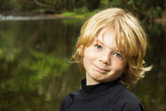Smiling boy child outside Stock Image