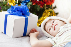 Smiling boy with christmas holiday gift box Stock Images