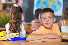 Smiling boy in classroom at school Royalty Free Stock Photo