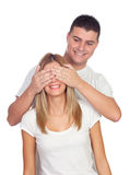Smiling boy covering his girlfriend's eyes to surprise him Stock Photos