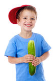 Smiling boy with cucumber Stock Photos