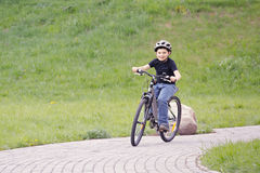 Smiling boy cycling in park Royalty Free Stock Photography