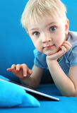 Smiling boy and digital tablet Stock Photos