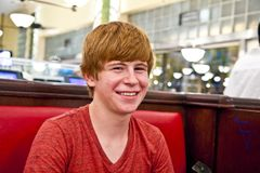 Smiling boy in a diners Royalty Free Stock Photo