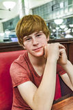 Smiling boy in a diners at night Stock Images