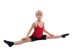 Smiling boy doing horizontal splits Royalty Free Stock Images