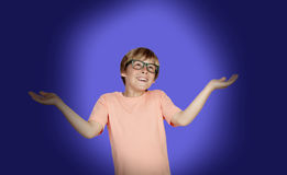 Smiling boy with a doubtful expression Stock Images