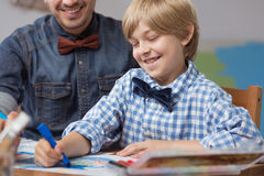 Smiling boy drawing Stock Photography